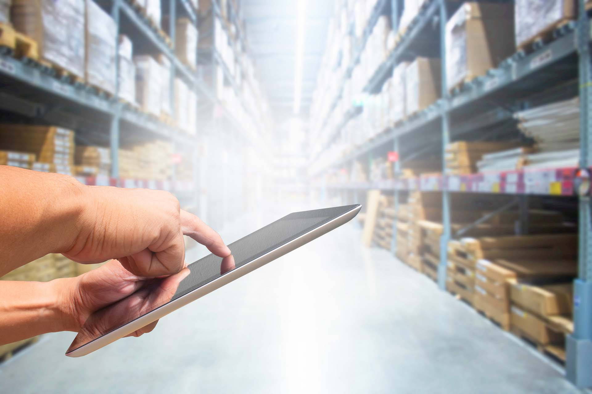 check stock tablet hand in warehouse store
